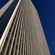 Stock Photo: Office Tower before Cloudless Sky on Sunny Day