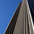 Stock Photo: Office Building before Cloudless Blue Sky