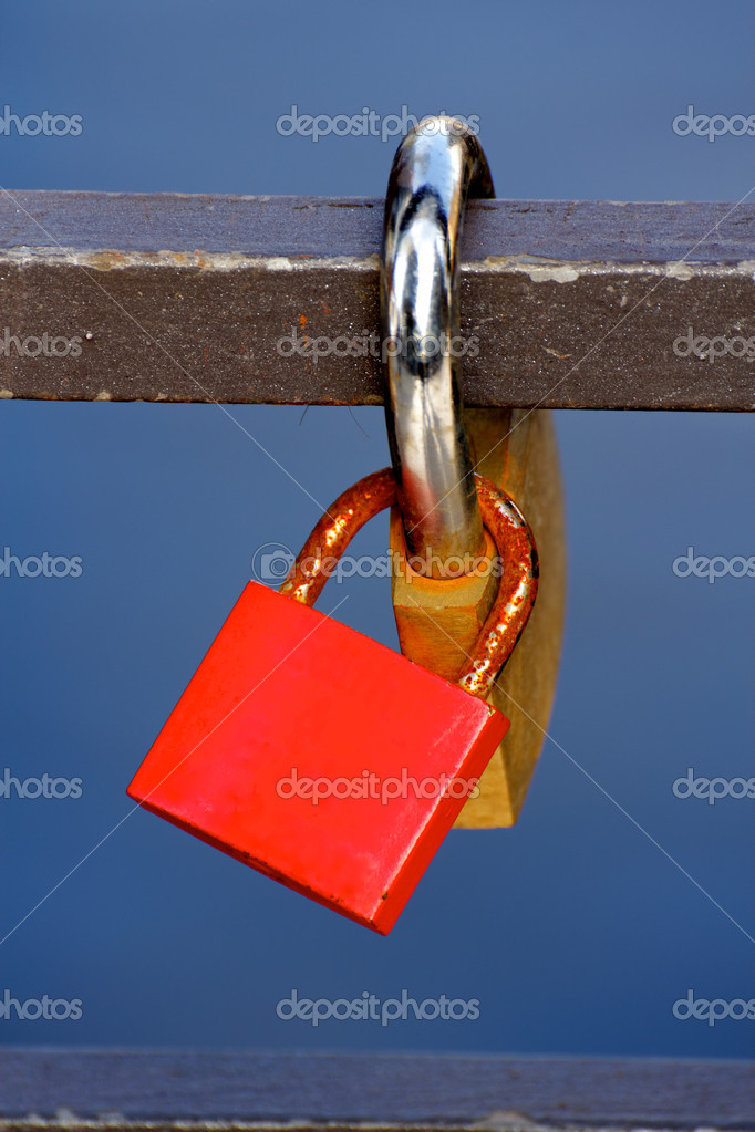 Love Padlocks or Love Locks, a modern symbol of lov and marriage, attached to a bridge. — Stock Photo #9327857