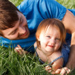 Happy Father And Daughter Laying In Grass — Stock Photo
