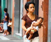 Teenage mothers/ Single moms in Asia — Stock Photo