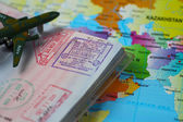 Passport and world map — Stock Photo