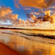 Sunset on the beach — Stock Photo #9998150