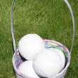 Softball balls in a easter basket — Stock Photo