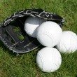 Softball glove and balls — Stock Photo