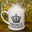 Prince charming cup of tea on — Stock Photo