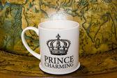 Prince charming cup of tea on — Stock Photo
