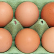 Stock Photo: Half dozen eggs background