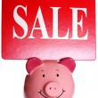 Sale sign and piggybank — Stock Photo
