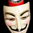 Guy fawkes mask with cahrity collection — Stock Photo #8844465