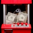 Stock Photo: Americmoney in grabbing machine
