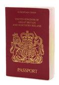 Britský pas na bílém pozadí — Stock fotografie