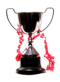 Trophy with red ribbon — Stock Photo