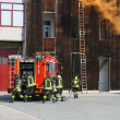Firefighters in action during an exercise in the Firehouse - Stock Photo