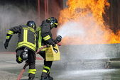 Firefighters in action during an exercise in the Firehouse — Stock Photo