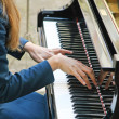 Stock Photo: Hands gently playing melody on piano