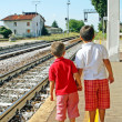 Two brothers,children waiting for the train station - Stok fotoğraf