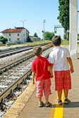 Two brothers,children waiting for the train station — Stock Photo