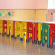 Постер, плакат: Chairs and tables in a dining hall for a kindergarten