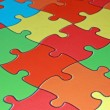 Colored pieces of a complicated puzzle — Stock Photo