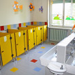 Stock Photo: Bathroom and toilet with small sinks asylum