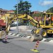 Stock Photo: Roadworks with a scraper to work in the middle of the road