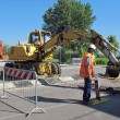 Roadworks with a scraper to work in the middle of the road — Stock Photo #10475136