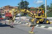 Roadworks with a scraper to work in the middle of the road — Stock Photo