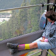 Womsitting on cabin of cable car — 图库照片 #10560879