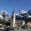 Stock Photo: Bell Tower of church and background of Dolomites in Ca