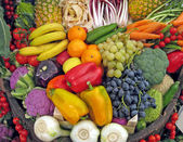 Basket full of grapes, peppers, cabbage, carrots, radish — Foto Stock