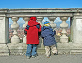 Children who watch from the railing — Stock Photo