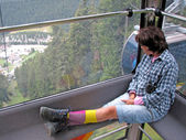 Woman sitting on the cabin of a cable car — Stok fotoğraf