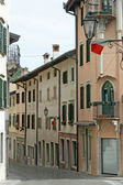Narrow country road in Friuli Gemona with Italian flags — Stock Photo
