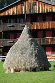 Haystack of dry grass and a typical House — Stock Photo