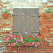 Royalty-Free Stock Photo: Wooden balcony on the wall of red brick