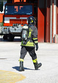 Fireman with oxygen tank during an exercise in the barracks — Stock Photo