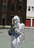 Firefighters with special suit against radiation and radioactivi — Stock Photo