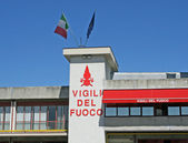Written in a fire station with Italian flags waving — Stock fotografie