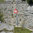 Stock Photo: Sign of caution and danger on edge of precipice