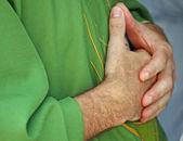 Hands clasped in prayer the priest with dress — Stock Photo