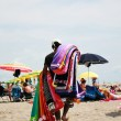 Stock Photo: Hawker beach towels on beach in sand