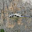 Helicopter for the transport of materials in the high mountains at high alt - Stok fotoğraf