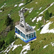 Cable car or  funicular railway to transport tourists on the mountain top — Stock Photo
