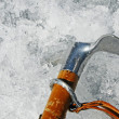 Ax hook firmly fixed in a wall of ice in high mountains — Stock Photo