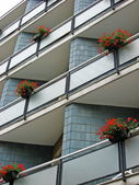 Flowered balconies with pots of geraniums — Stock Photo