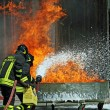 Firefighters extinguished a fire hazard during a training exercise in the f — Stock Photo