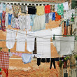 Stock Photo: Street in venice with washing hung out to dry in the sun over the water cha