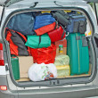 Baggage and luggage loaded onto the trunk of a car going on holiday with hi - Stock Photo