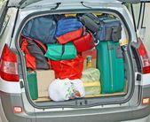 Baggage and luggage loaded onto the trunk of a car going on holiday with hi — Stock Photo